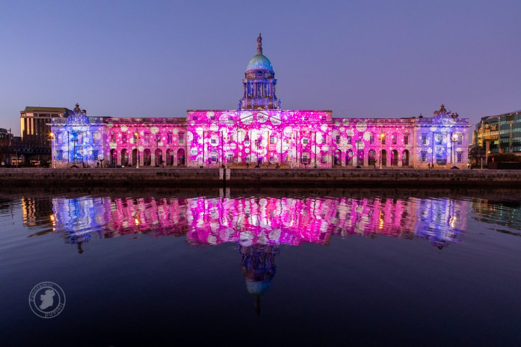 Dublin's Custom House with striking colours reflected in the River Liffey as part of Winter Lights Dublin